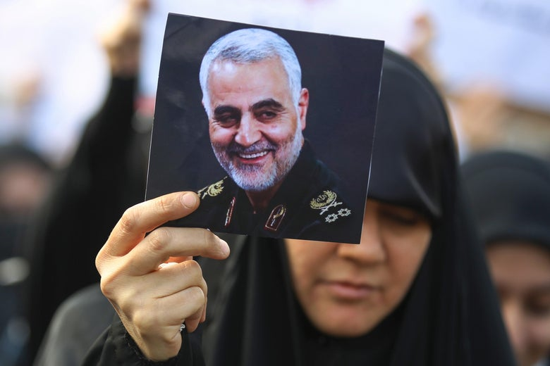 An Iraqi woman attends the funeral of Iranian military commander Qasem Soleimani (portrait), Iraqi paramilitary chief Abu Mahdi al-Muhandis and eight others in Baghdad's district of al-Jadriya, in Baghdad's high-security Green Zone, on January 4, 2020.