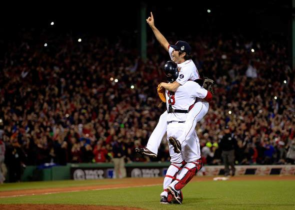 Koji Uehara, No. 19, and David Ross, No. 3, of the Boston Red Sox, celebrate after defeating the St. Louis Cardinals in Game 6 of the 2013 World Series on Oct. 30, 2013.