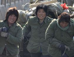 Migrant workers in China. Click image to expand.