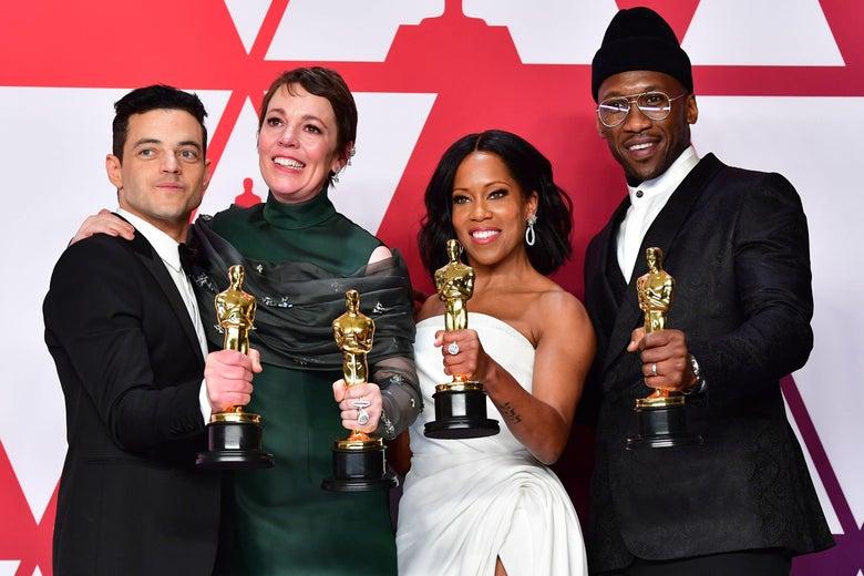 Rami Malek, Olivia Colman, Regina King, and Mahershala Ali hold up their Oscars.