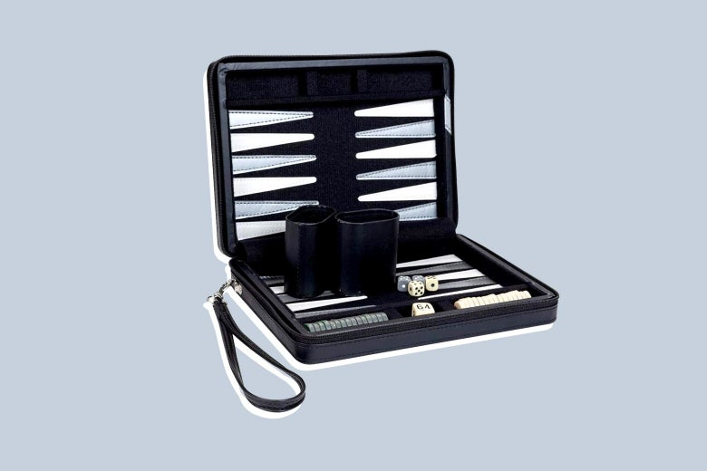 A compact travel magnetic backgammon set with carrying strap