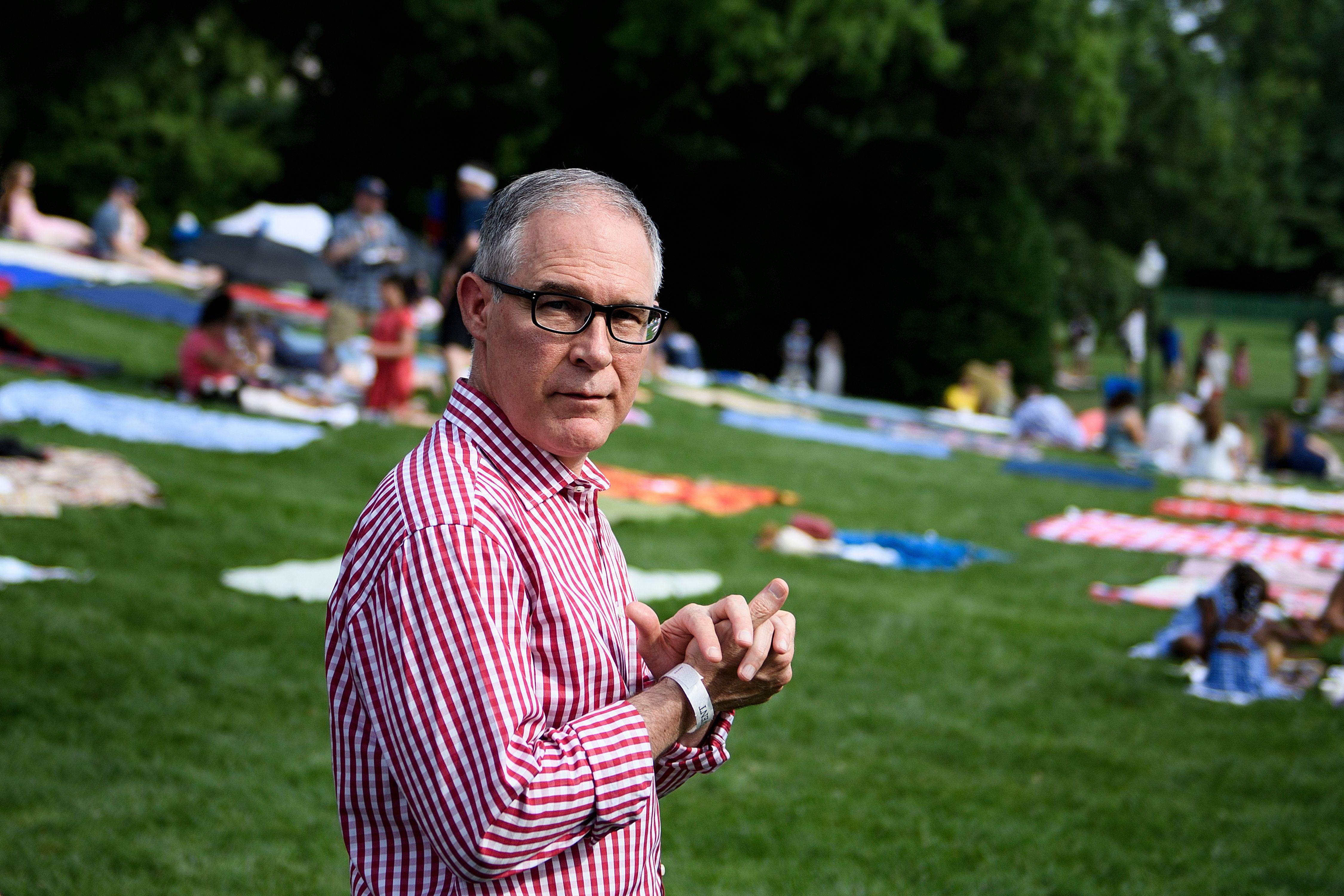 Scott Pruitt walks during a picnic for military families on the South Lawn of the White House July 4, 2018 in Washington, DC.