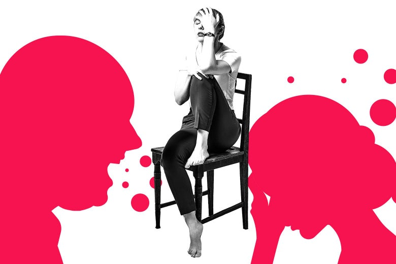 A woman looks exhausted/upset while sitting in a chair.