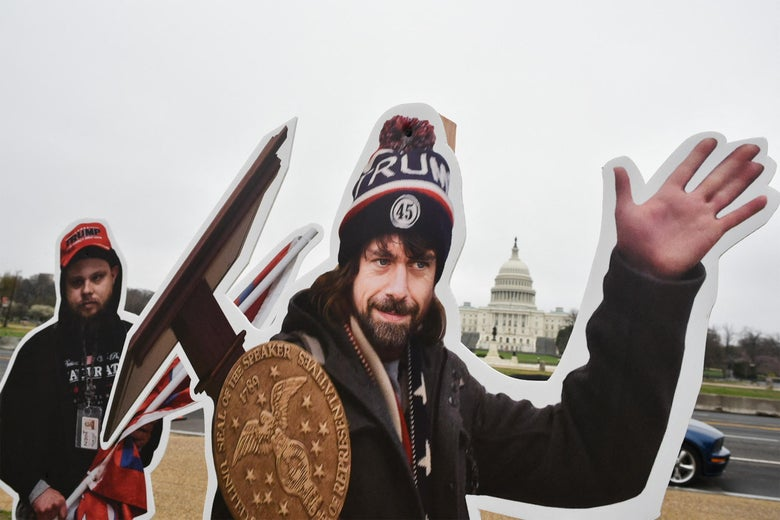 With the Capitol in the background, Jack Dorsey's face is on that of a man wearing a Trump hat and waving as he carries a lectern.