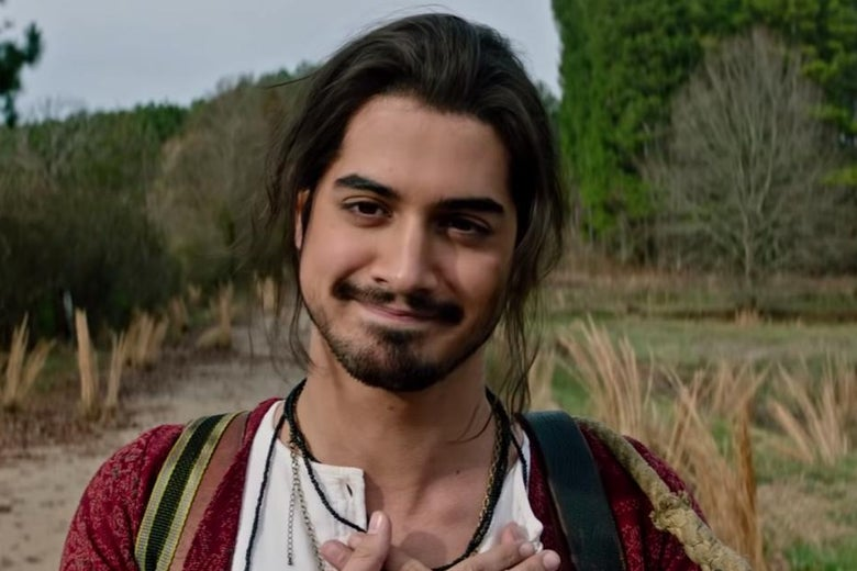 Avan Jogia as Berkeley, pressing his hands over his heart.
