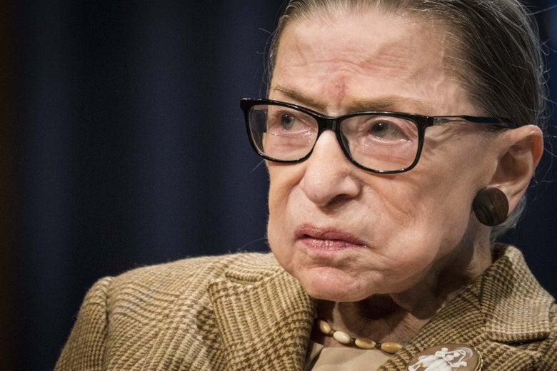 Ruth Bader Ginsburg in a brown tweed suit jacket.
