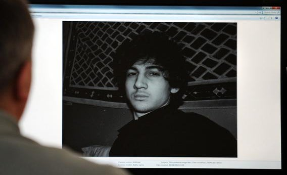 A man looks in Moscow on April 19, 2013, at a computer screen displaying an undated picture the 19-year-old Dzhokhar Tsarnaev posted on his is page in VKontakte, a Russian social media site.