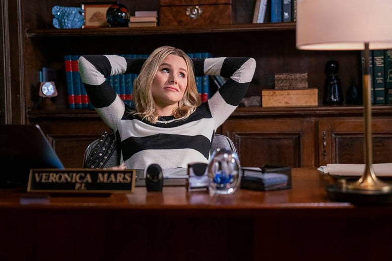 Kristin Bell as Veronica Mars sitting at her desk.