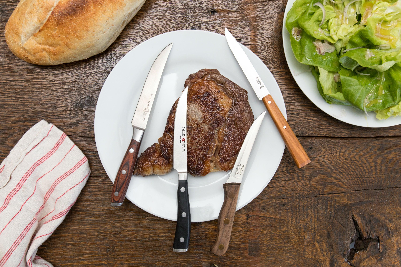 knives beside a steak