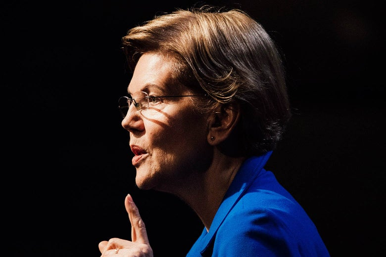 Elizabeth Warren seen in profile with a finger pointing up.