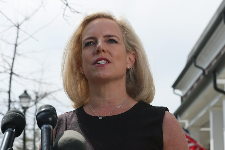 Kirstjen Nielsen speaks at a mic outside her house.