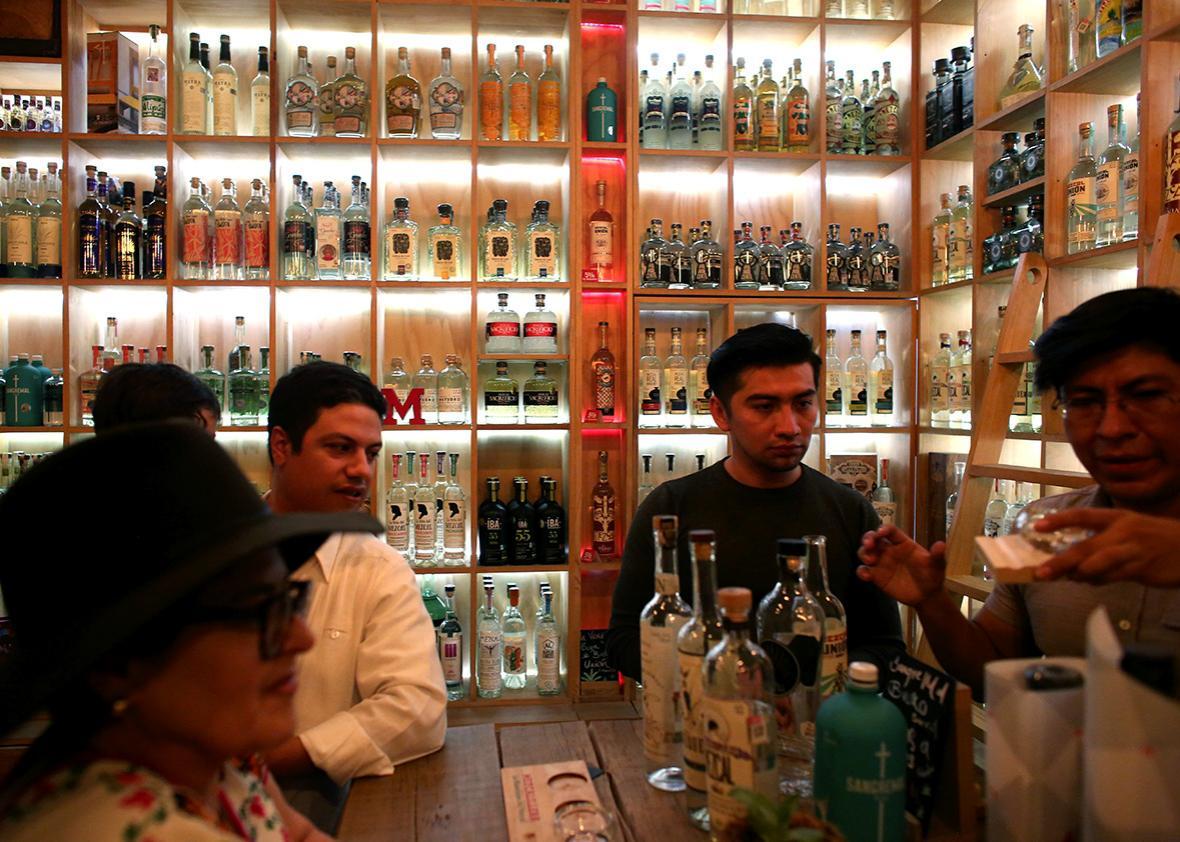 Tourists from Guadalajara sample mezcals at Mezcalilira in Oaxaca City.