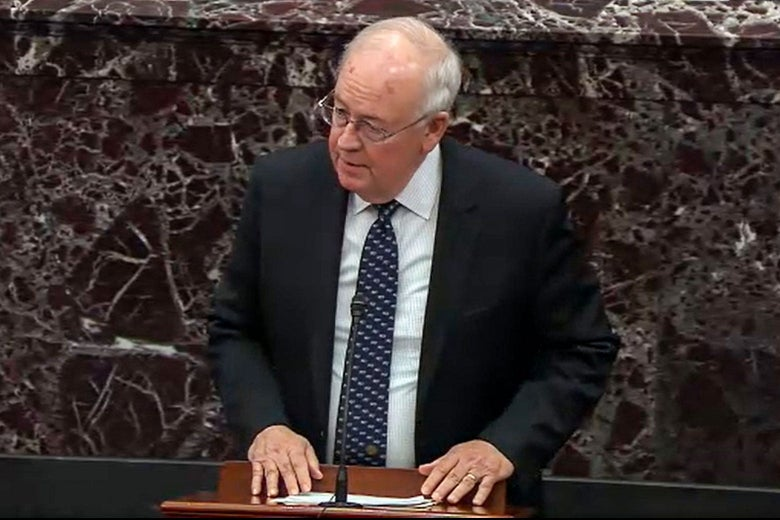 Starr standing at a lectern