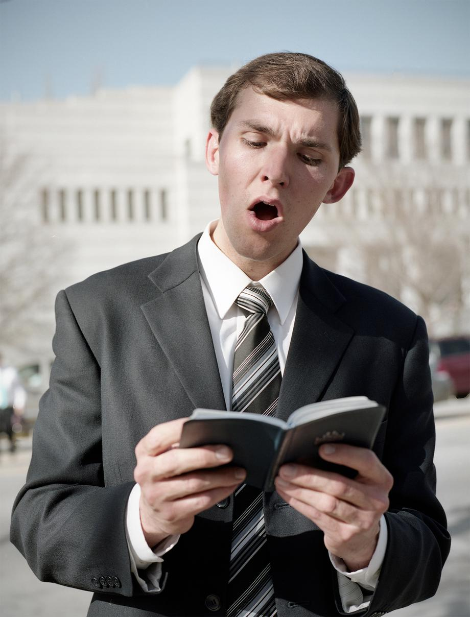 A Mormon man sings hymns on the street in between sessions during LDS general conference in Salt Lake City in April 2012.