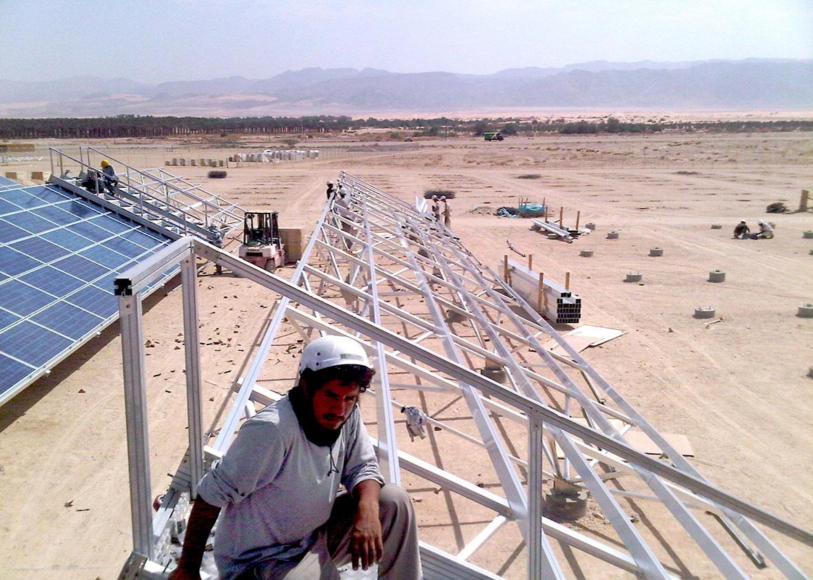 A construction worker in Israel's first solar field, Ketura Sun,