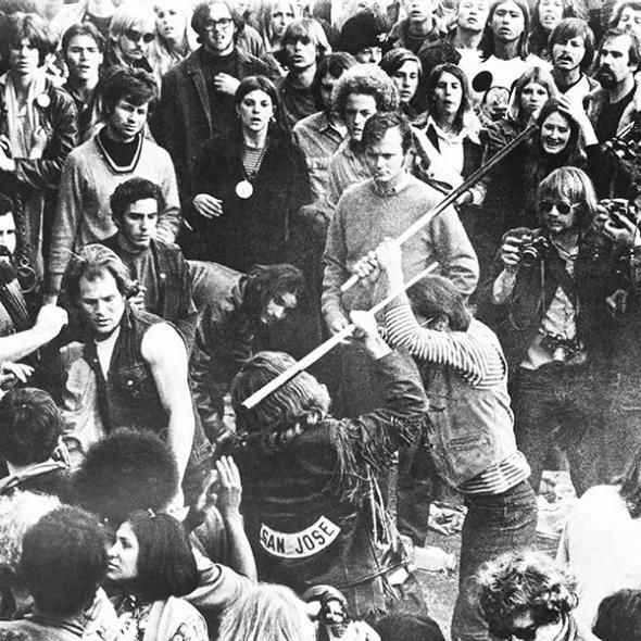The legendary motorcycle group Hell's Angels fight with pool cues during the Altamont Free Concert.