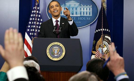 President Obama calls on reporters during a news conference.