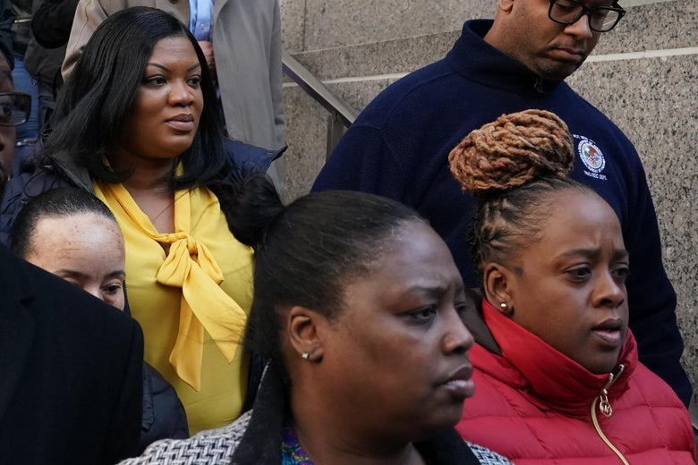 Metropolitan Correctional Center guard Tova Noel (yellow shirt) surrounded by supporters leaves Federal Court in New York City on November 25, 2019.