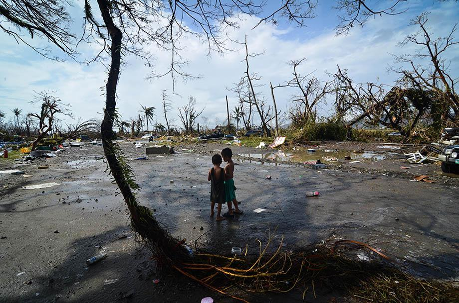 Two young boys look at the devastation in the aftermath of typhoon Haiyan on November 10, 2013 in Tacloban City, Leyte, Philippines.