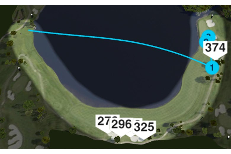 An aerial view of the dogleg sixth hole with the trajectory of DeChambeau's drive cutting across the wide part of the water.