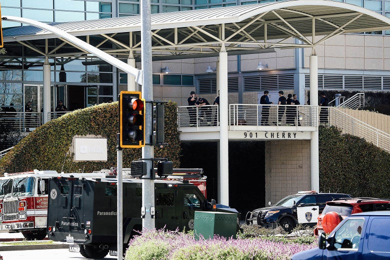 Police officers stand by in front of the YouTube headquarters on Tuesday in San Bruno, California.