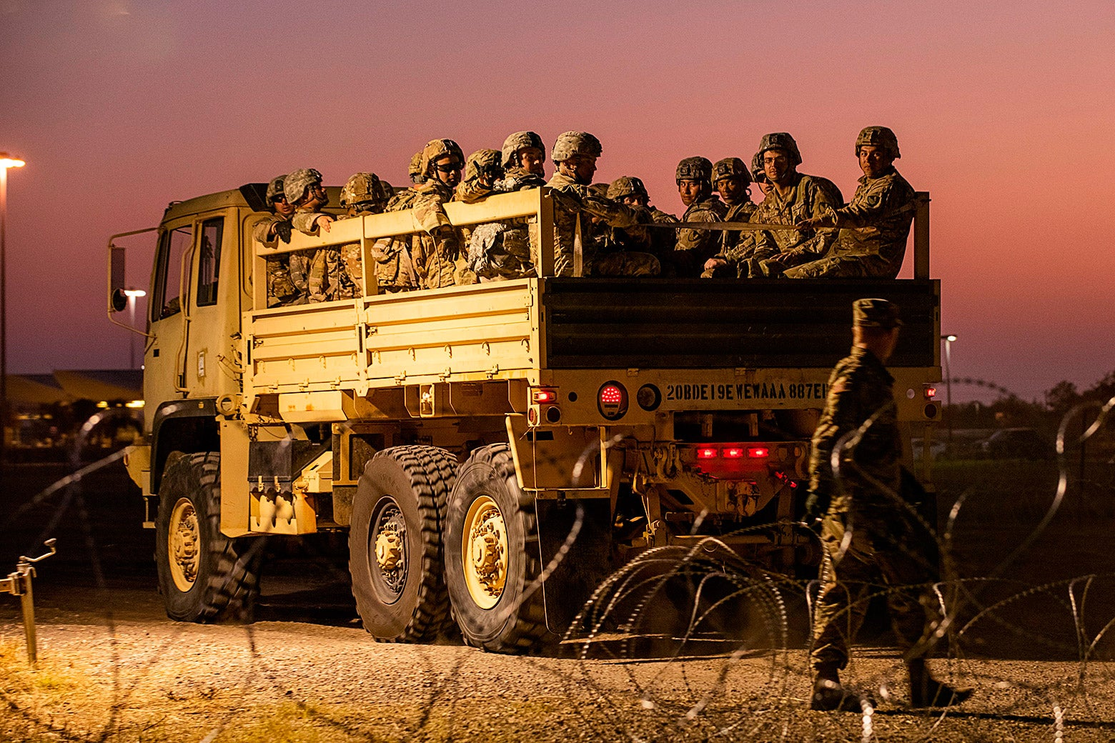 U.S. Army troops enter a compound where the military is erecting an encampment near the U.S.-Mexico border crossing.