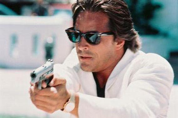 "Don Johnson in a signature white suit, on ""Miami Vice."""