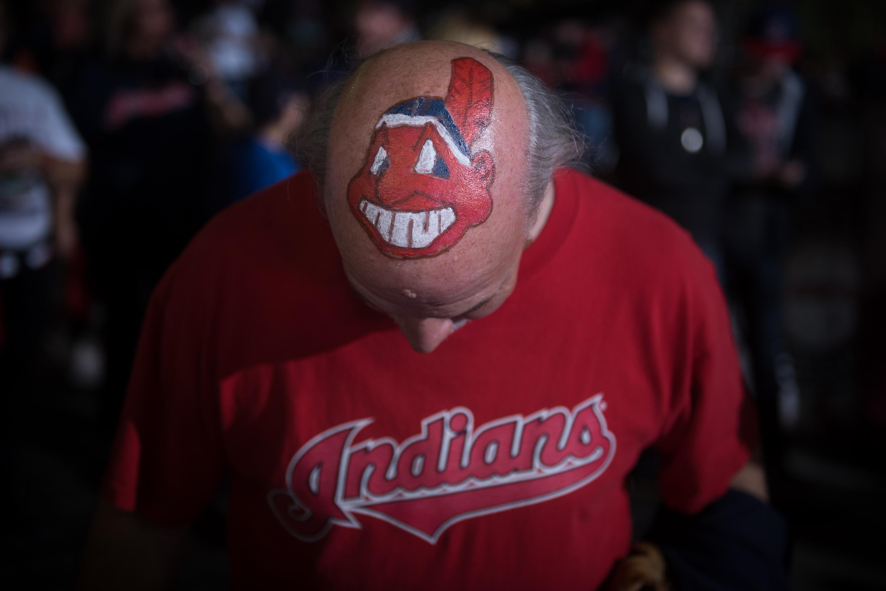 A fan shows off his Cleveland Indians mascot-painted head prior to game 6 of the World Series against the Chicago Cubs on November 1, 2016 in Cleveland, Ohio.