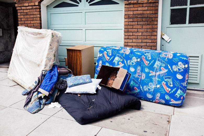 A mattress and other personal items outside a home following an eviction.
