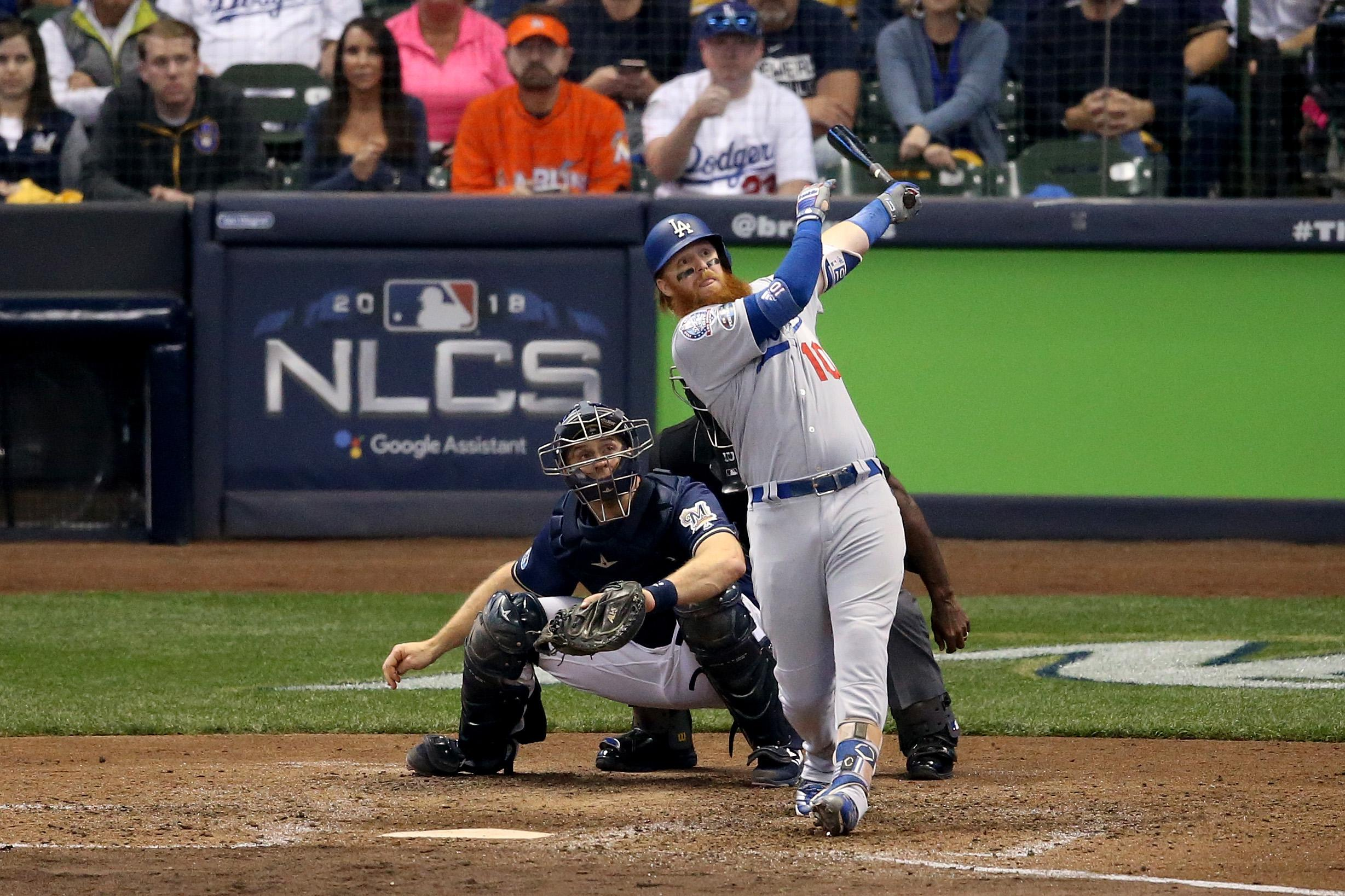 MILWAUKEE, WI - OCTOBER 13:  Justin Turner #10 of the Los Angeles Dodgers hits a two run home run against Jeremy Jeffress #32 of the Milwaukee Brewers during the eighth inning in Game Two of the National League Championship Series at Miller Park on October 13, 2018 in Milwaukee, Wisconsin.  (Photo by Dylan Buell/Getty Images)
