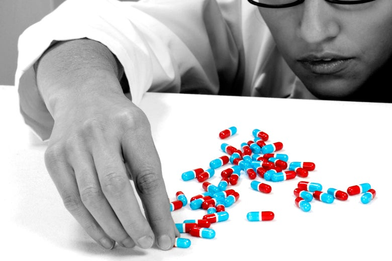 A pharmacist counting pills.