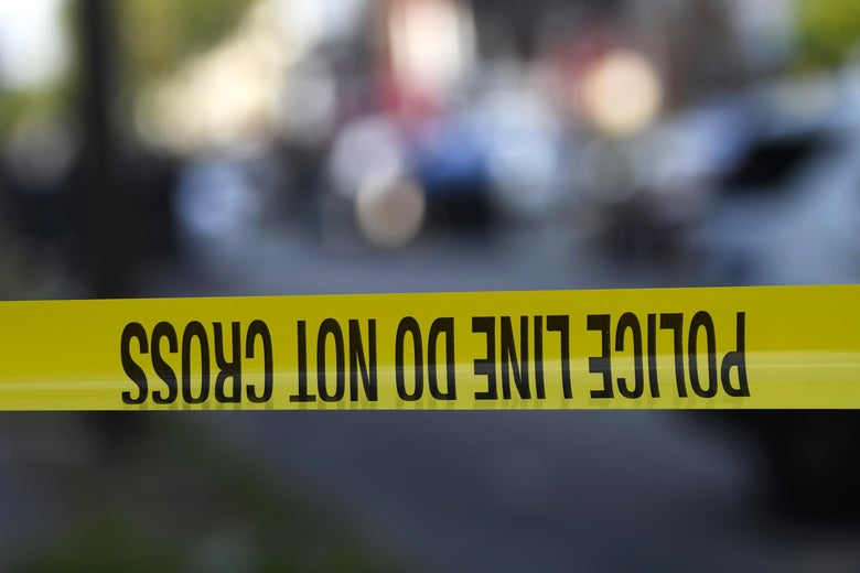 Police tape is stretched across a street near a residence during a shooting on August 14, 2019 in Philadelphia, Pennsylvania.