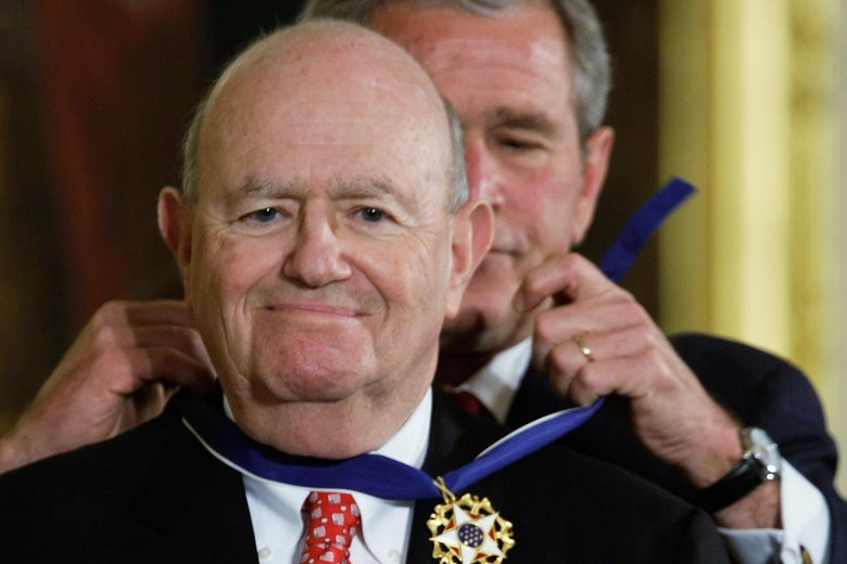 Laurence Silberman smiles while George W. Bush places the Presidential Medal of Freedom around his neck.