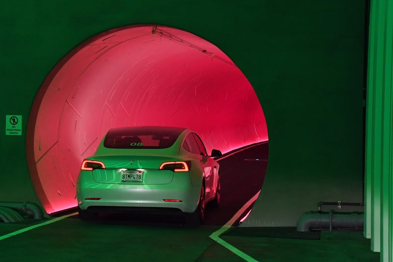 A Tesla car drives through a tunnel in the Central Station during a media preview of the Las Vegas Convention Center Loop on April 9, 2021 in Las Vegas, Nevada.