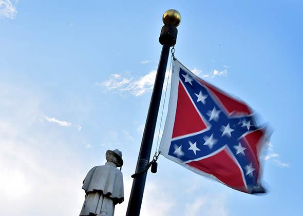 The Confederate flag is seen next to the monument of the victims,The Confederate flag is seen next to the monument of the victims of the Civil War in Columbia, South Carolina.
