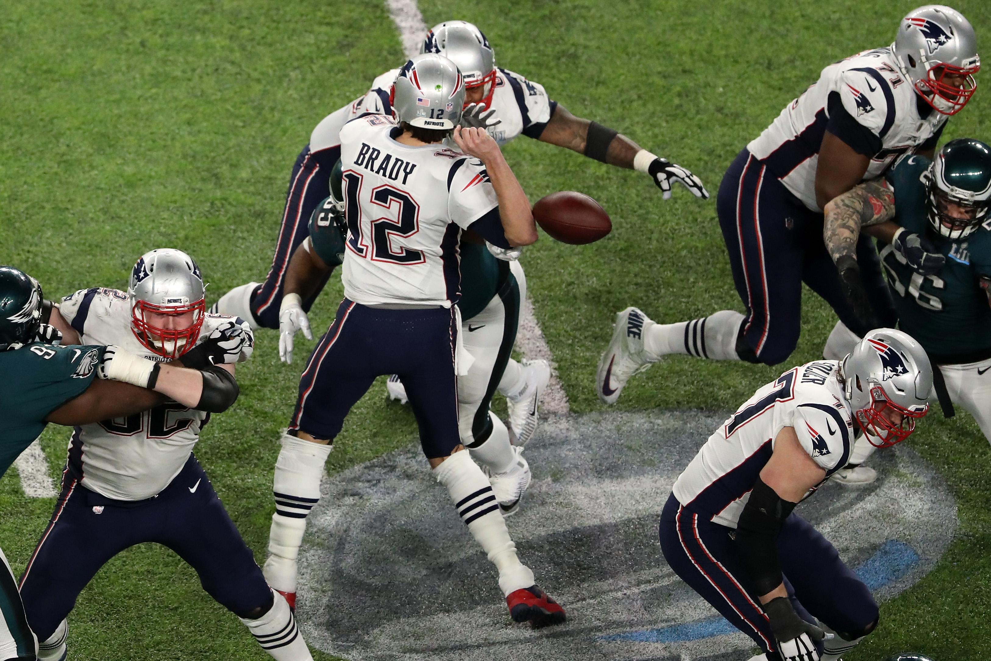 MINNEAPOLIS, MN - FEBRUARY 04:  Tom Brady #12 of the New England Patriots has the ball stripped by Brandon Graham #55 of the Philadelphia Eagles late in the fourth quarter in Super Bowl LII at U.S. Bank Stadium on February 4, 2018 in Minneapolis, Minnesota.  (Photo by Christian Petersen/Getty Images)