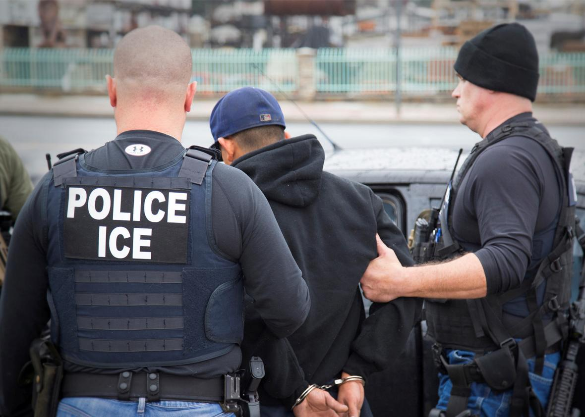 U.S. Immigration and Customs Enforcement (ICE) officers detain a,U.S. Immigration and Customs Enforcement (ICE) officers detain a suspect