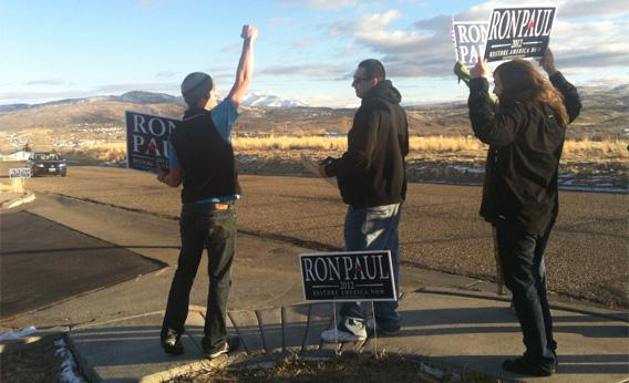 Supporters of Ron Paul direct cars into the parking lot before a rally in Elko, Nev.