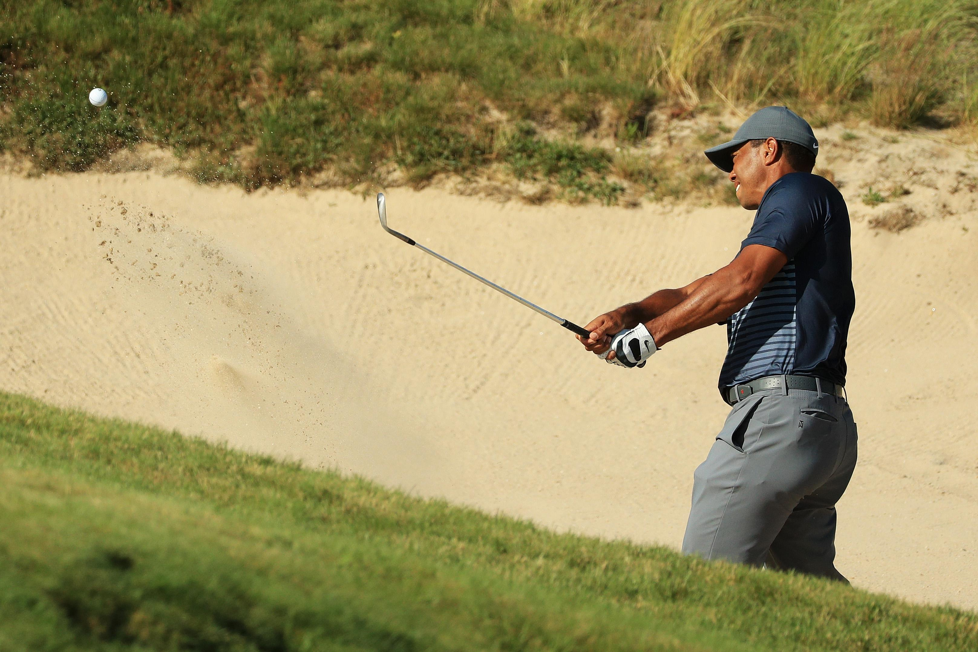 Tiger Woods, falling out of contention.