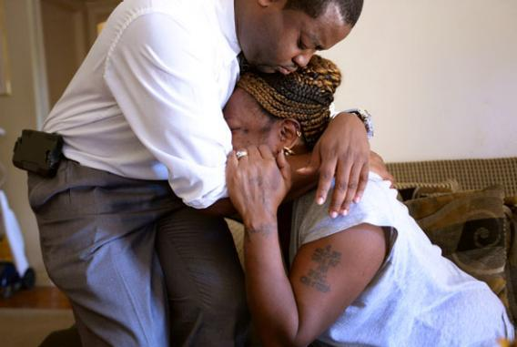 Priscilla Daniels, wife of victim Arthur Daniels, is comforted by Lynnell Humphrey, who came to assist the family with arrangements on September 17,  2013 in Washington, DC.
