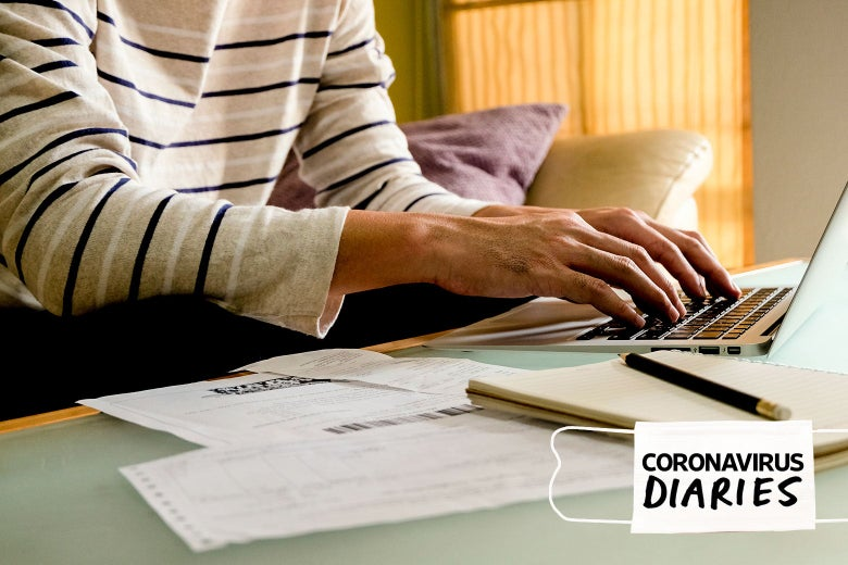 A person types on a computer next to some bills and other financial documents.