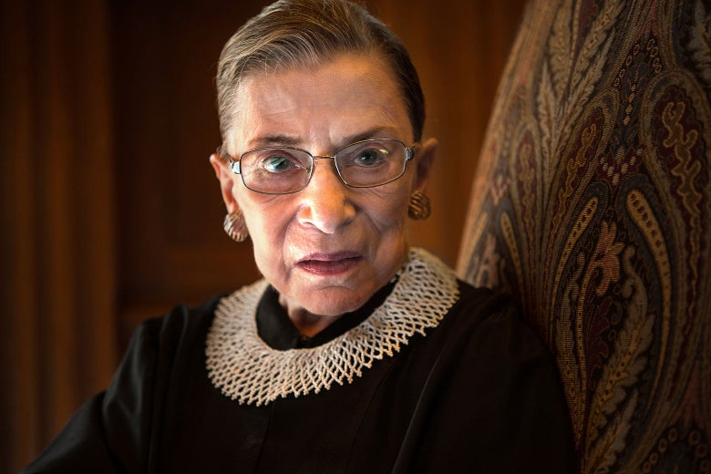 RBG, in her robes, looks at the camera