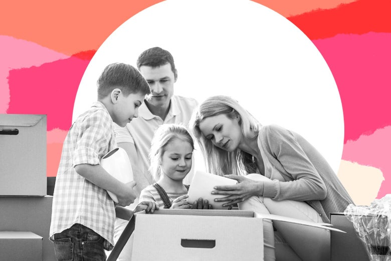 A family packs stuff in a box.