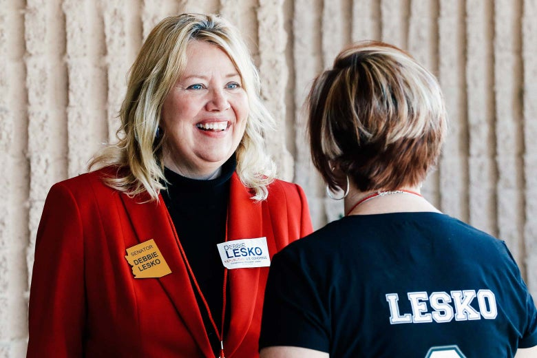 Arizona State Rep. and U.S. House candidate Debbie Lesko speaks with a constituent during the meeting of the state committee of the Arizona Republican Party on Jan. 27 in Phoenix.