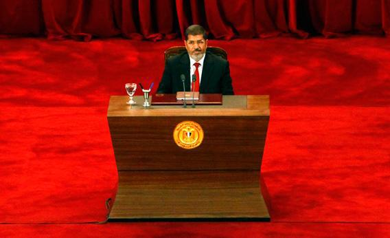 President Mohamed Morsi delivers a speech at Cairo's University after being sworn-in at the Constitutional Court in Cairo, on June 30, 2012.