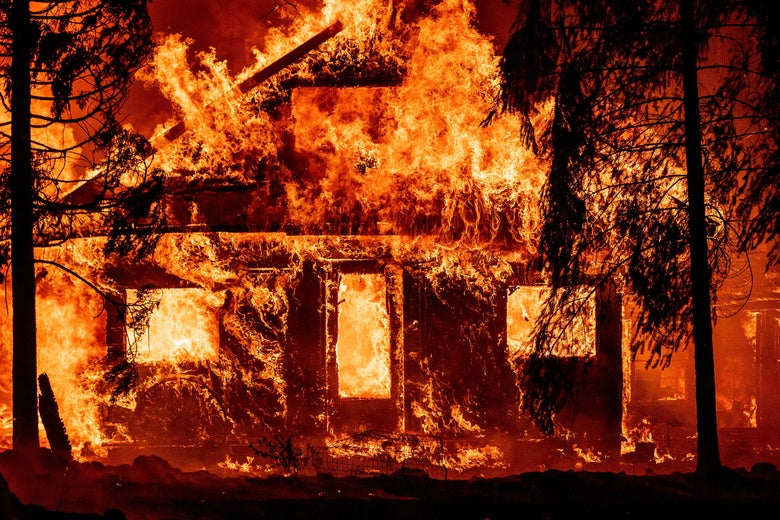 A home entirely engulfed in flames.