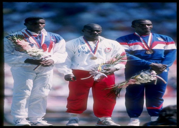 Carl Lewis of the United States (left) stands with Ben Johnson of Canada (center) and Linford Christie of Great Britain after completion of the 100 meter final at the Summer Olympics in Seoul, South Korea.