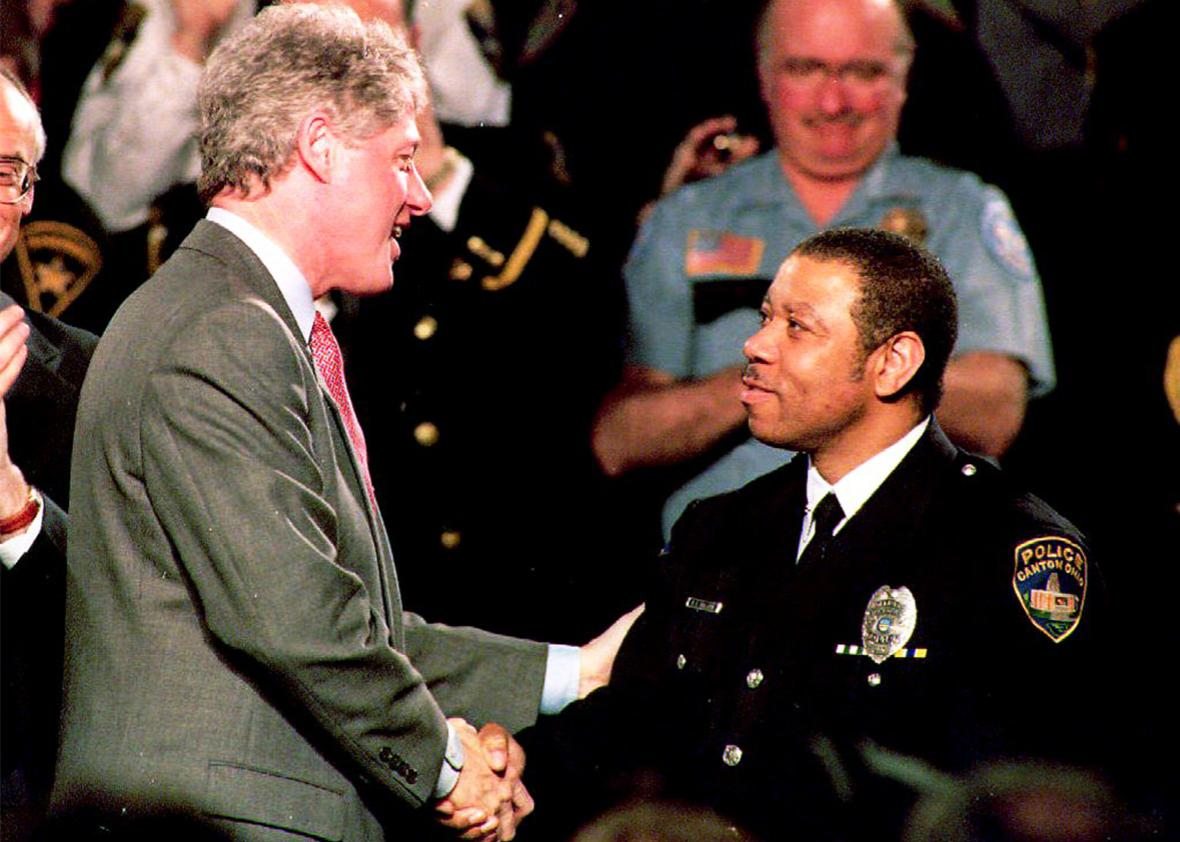 President Bill Clinton shakes hands with Ray Skillern, a 12-year veteran of the Canton, Ohio, police force in February 1994.