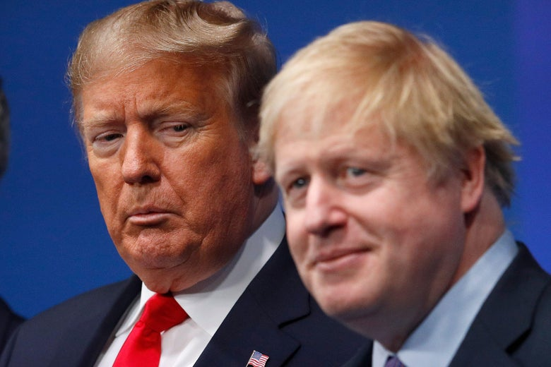 President Donald Trump makes a face while looking at British Prime Minister Boris Johnson.