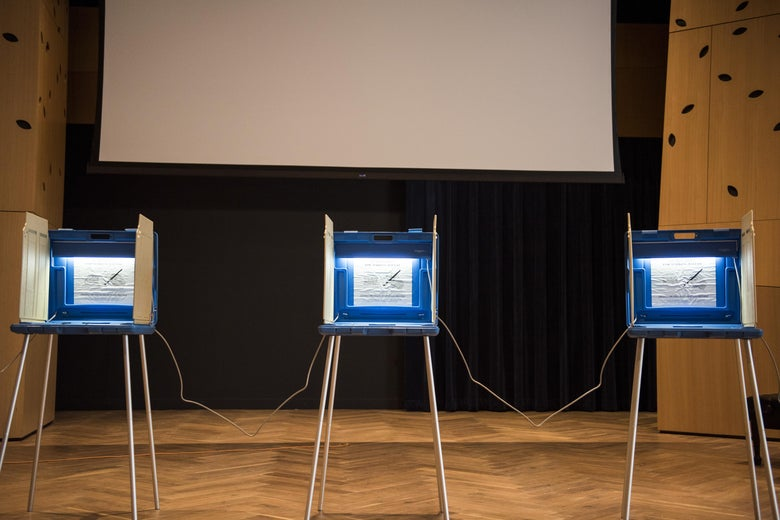 Three voting booths inside the Westminster Presbyterian Church in Minneapolis